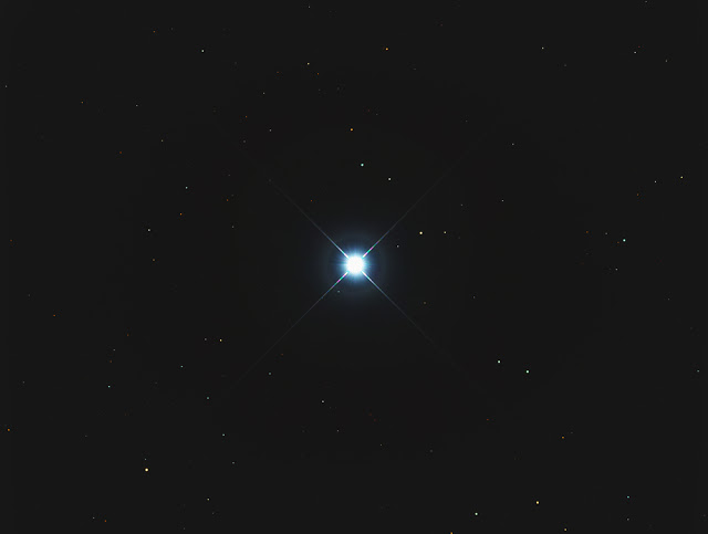 A quasar as seen by the Hubble Telescope, but the resolution provided by space and Earth-based telescopes in combination is far greater.
