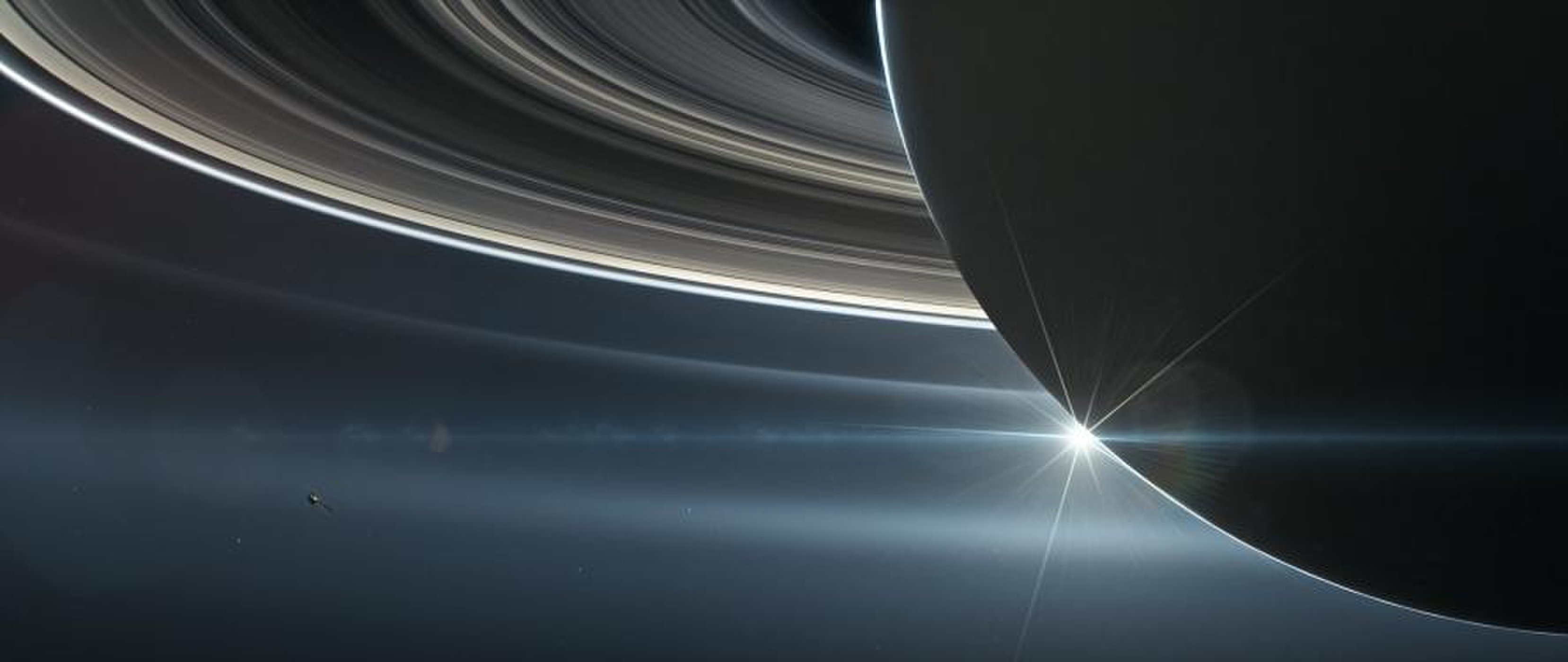 An artist's depiction of the Cassini spacecraft orbiting Saturn near the end of its mission.
