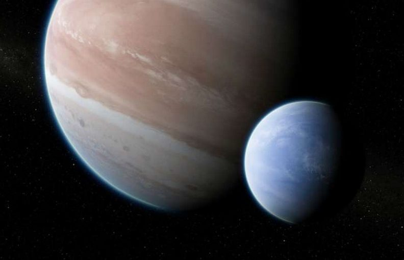 Artist's impression of the exoplanet Kepler-1625b, transiting the star, with the candidate exomoon in tow.