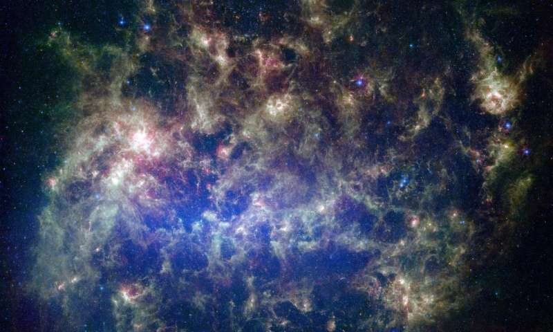 This vibrant image from NASA's Spitzer Space Telescope shows the Large Magellanic Cloud, a satellite galaxy to our own Milky Way galaxy.