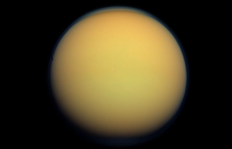 HAZY HAVEN Titan may get its hazy atmosphere (shown in natural color in this image from NASA's Cassini spacecraft) from organic molecules warmed by the decay of radioactive elements in the moon's core.
