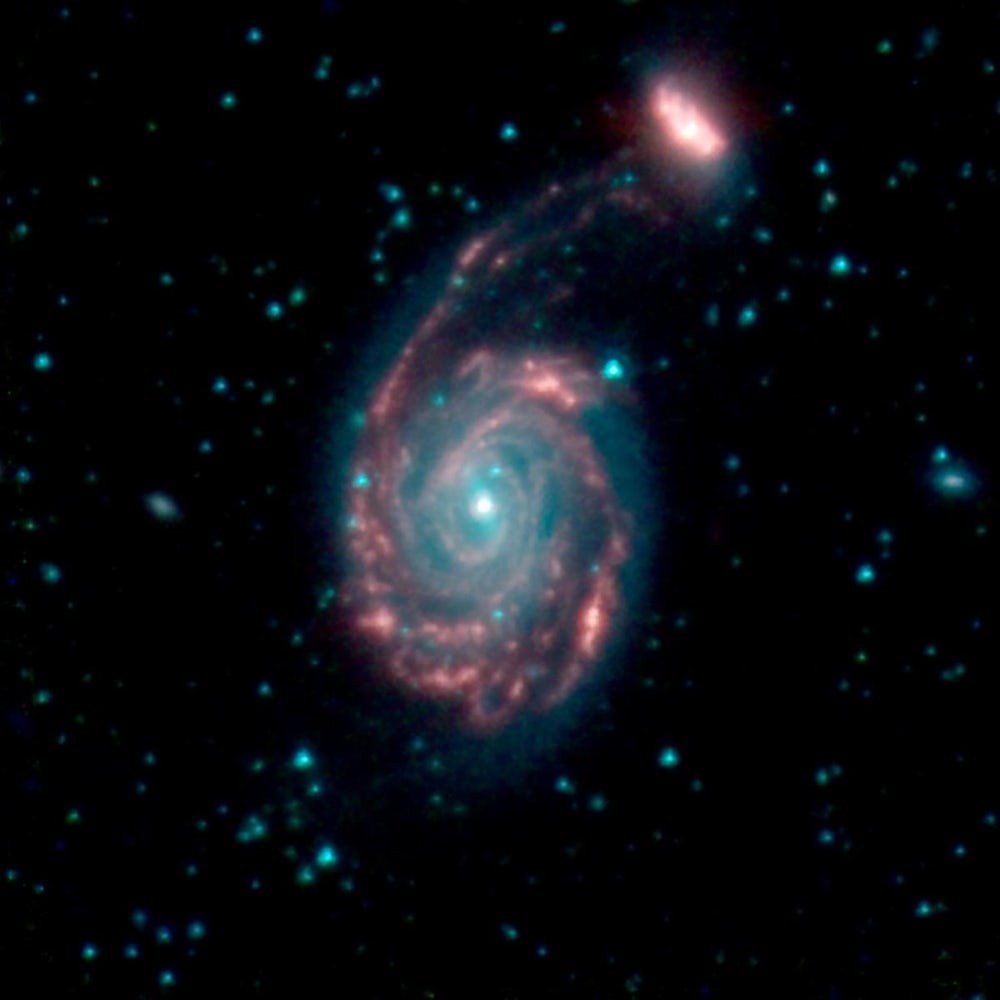The merger of two galaxies, known as NGC 7752 (larger) and NGC 7753 (smaller), also collectively called Arp86