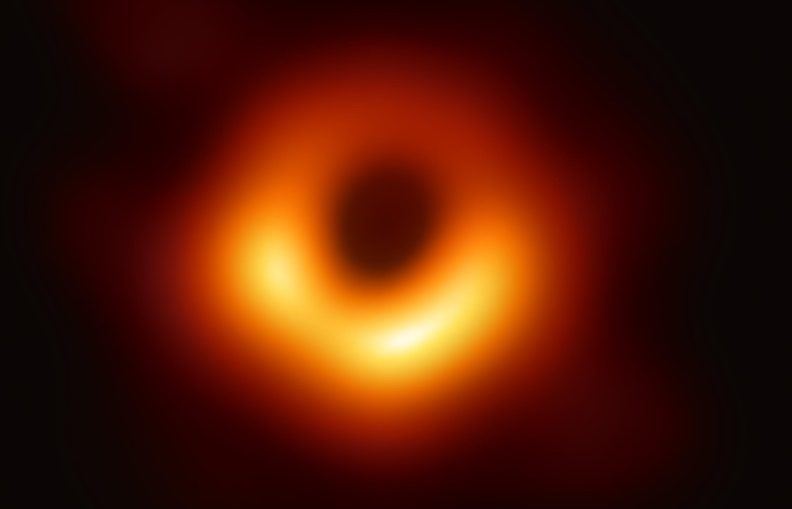 """The first-ever image of a black hole was released Wednesday by a consortium of researchers, showing the """"black hole at the center of galaxy M87, outlined by emission from hot gas swirling around it under the influence of strong gravity near its event horizon."""""""