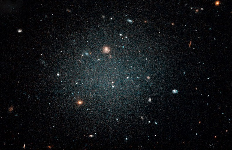 Astronomers have found two galaxies that appear devoid of dark matter, which they argue is in fact strong evidence of the elusive particle's existence.