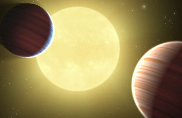 An artist's depiction of the stellar system Kepler-9 and two of its planets. Astronomers have confirmed the very low densities of two of Kepler-9's planets using both transit-timing and radial velocity methods. Credit: NASA, Jet Propulsion Laboratory/California Institute of Technology, Ames Research Center