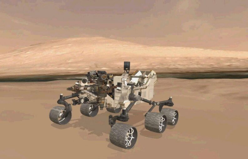 A 3D virtual model of Curiosity is shown inside Gale Crater on Mars.