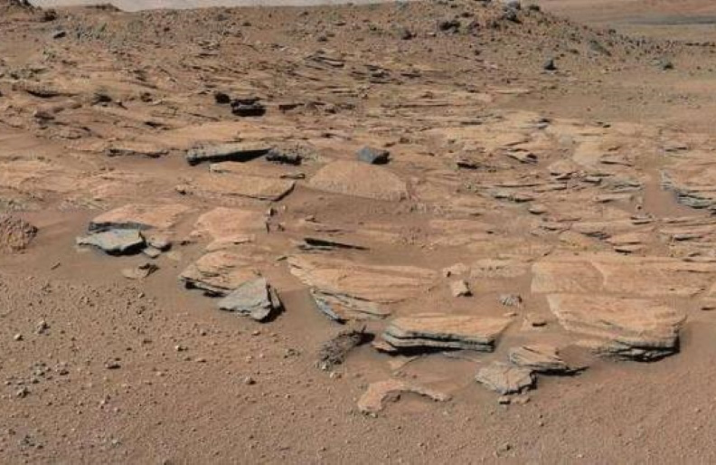 This NASA handout photo shows beds of sandstone inclined to the southwest toward Mount Sharp and away from the Gale Crater rim.