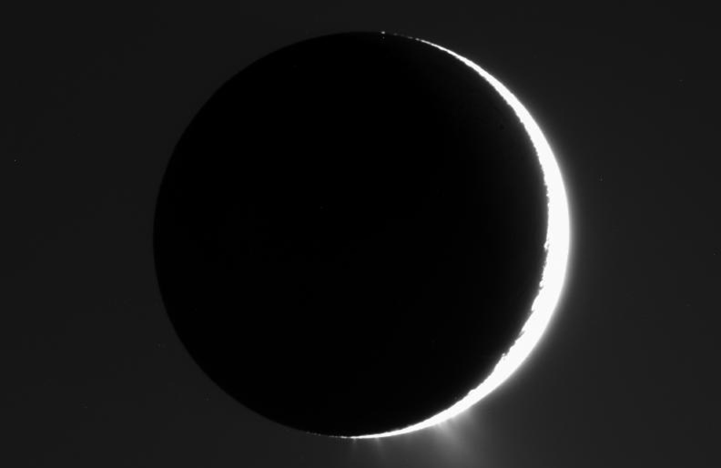 In this image captured by NASA's Cassini spacecraft in 2007, the plumes of Enceladus are clearly visible. The moon is nearly in front of the Sun from Cassini's viewpoint.