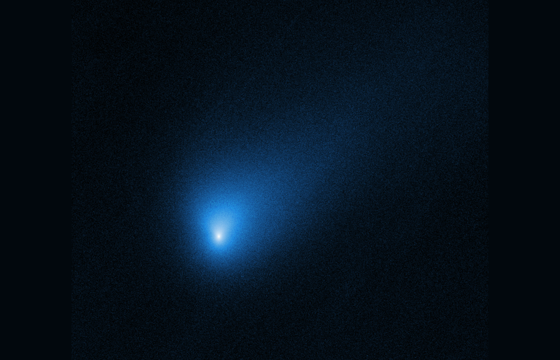Comet 2I/Borisov appears as a fuzzy blue dot in an image from the Hubble Space Telescope.