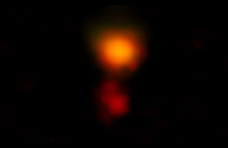 ALMA radio image of the dusty star-forming galaxy called MAMBO-9. The galaxy consists of two parts, and it is in the process of merging.